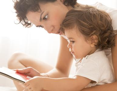 baby and mother with book