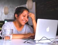 girl at home using computer