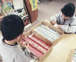 Children using clay to mold alphabet