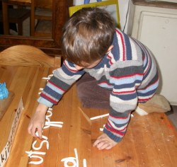 Boy modeling clay alphabet