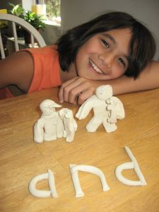 girl with clay model of word and