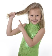 girl pointing to hair