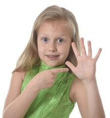 girl pointing to her hand