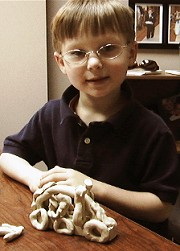 boy with clay model