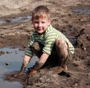 boy with hands in dirt
